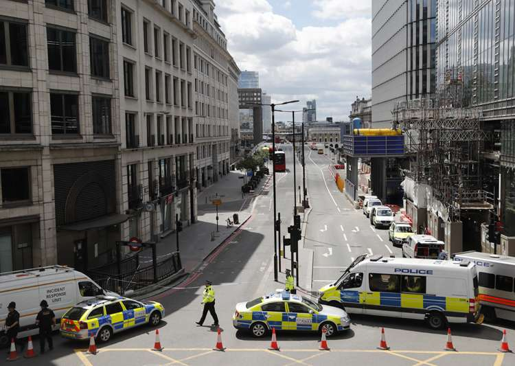 Police vans block access to a street after an attack in the