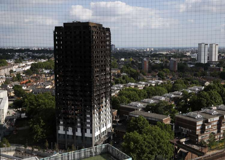 The remains of Grenfell Tower stand in London