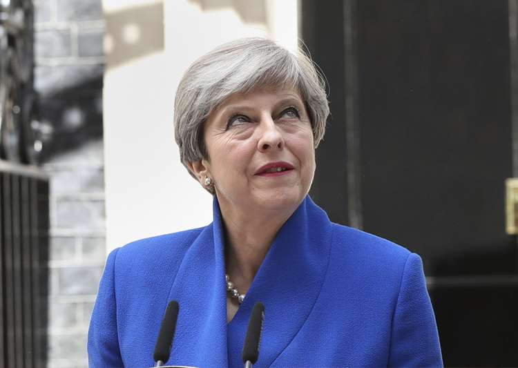 Theresa May speaks to the media outside 10 Downing Street- India Tv
