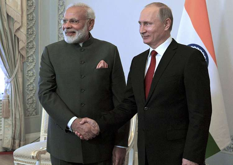 Putin shakes hands with Modi at the St. Petersburg- India Tv