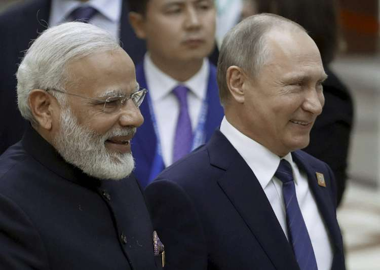 Putin and Modi walk together during a security summit in