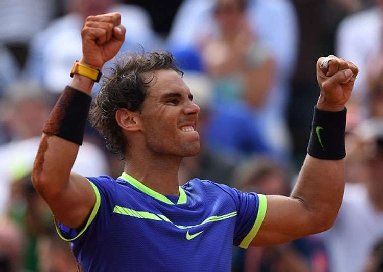 Rafael Nadal reacts after winning the French Open men's- India Tv