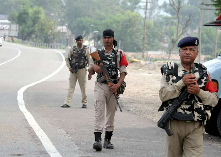 CRPF personnel patrol on Jammu-Srinagar highway on the eve