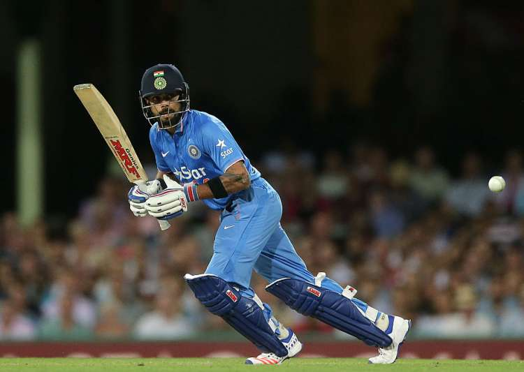 Virat Kohli of India playing a drive on the ON side.- India Tv