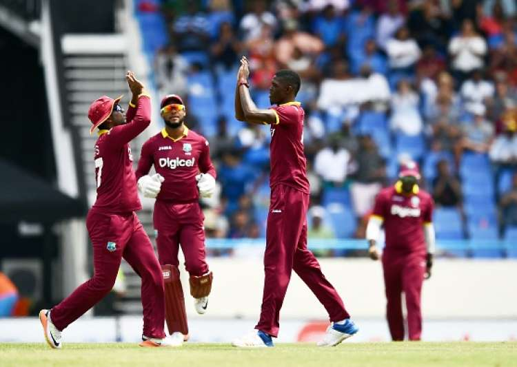 Alzarri Joseph R celebrates with teammates after- India Tv