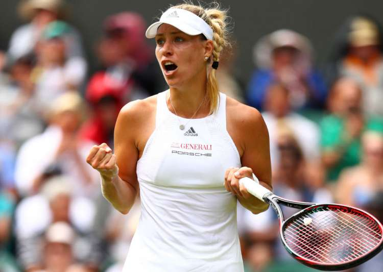 Angelique Kerber of Germany celebrates after winning the- India Tv