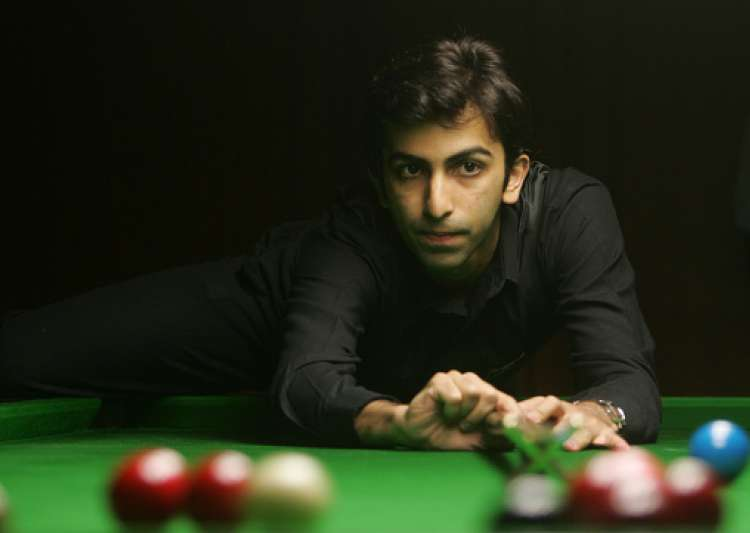 Cueist Pankaj Advani takes aim during his final match