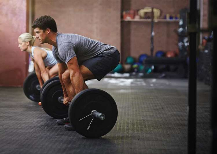 How heavy weight lifting boosts muscle strength- India Tv