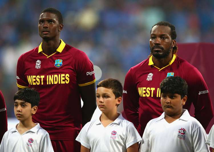 Jason Holder and Chris Gayle of the West Indies look on- India Tv