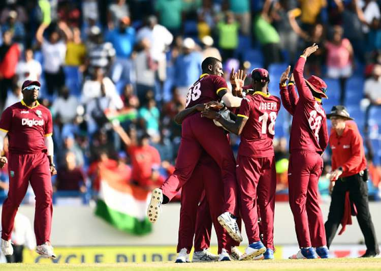 Jason Holder celebrates with teammates after defeating- India Tv