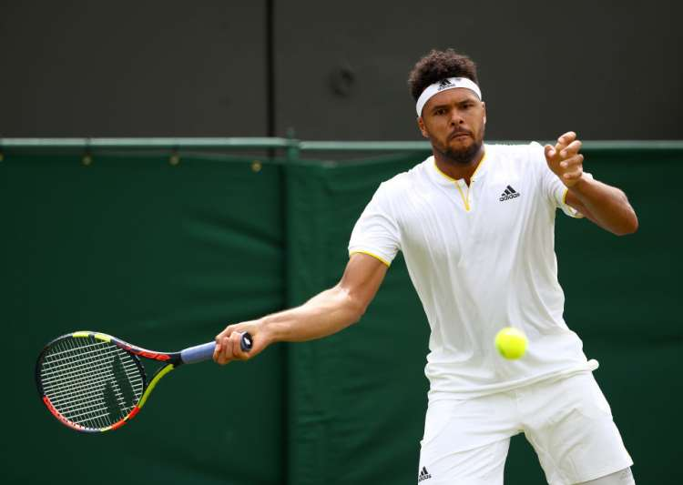 Jo-Wilfried Tsonga of France plays a forehand- India Tv