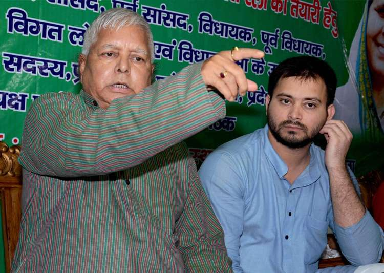Lalu Prasad addressing a press conference with Tejashwi