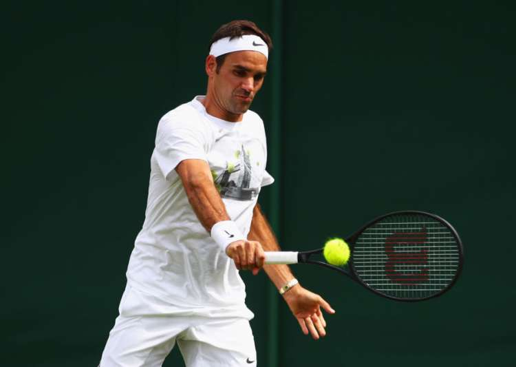 Roger Federer of Switzerland plays a backhand during- India Tv