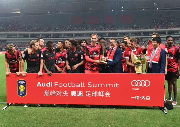 Arsenal players hit by food poisoning in China