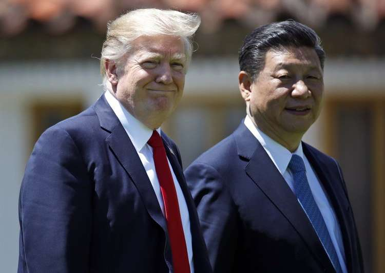 File pic - Trump and Jinping walk together after their- India Tv