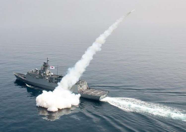 A South Korean navy ship fires a missile during a drill in- India Tv