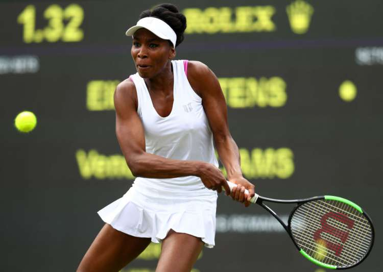 Venus Williams of the United States plays a backhand during- India Tv