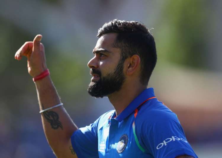 Virat Kohli walks off the field- India Tv