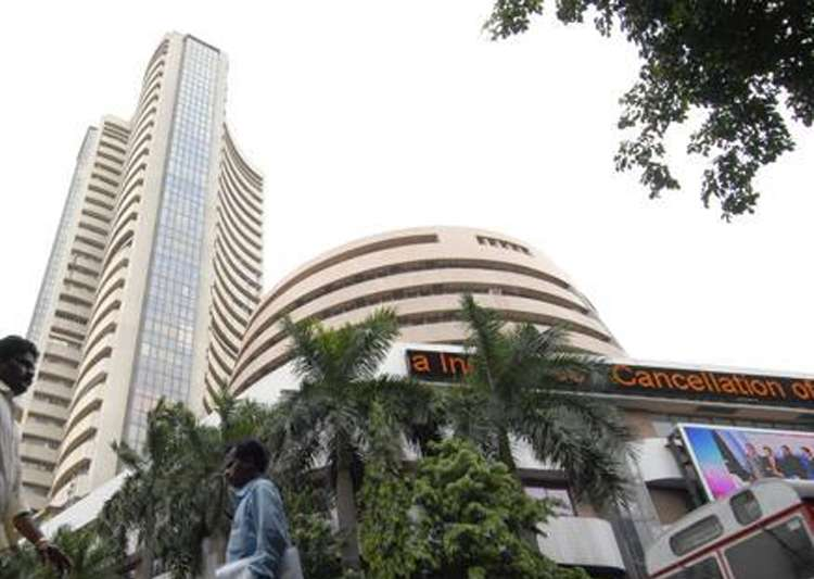 Sensex rises over 100 points; Nifty near 9800