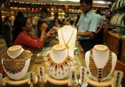 gold gains on wedding season silver sheds rs. 500