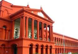 high court waits for rbi decision on bank penal charges for