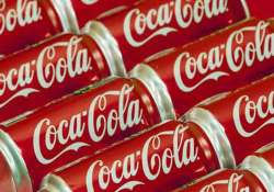 coca cola to cut 1 800 jobs globally
