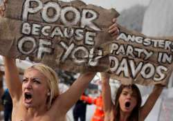 topless protesters take on movers and shakers at davos forum