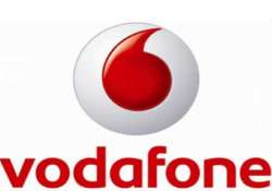 vodafone agrees to buy spanish network
