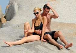 bikini clad hilton cosies up with boyfriend