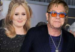adele apologises to elton john for missing his wedding
