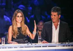 x factor judge cheryl says cowell is a genius