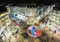 x men posters beamed on london s oxford circus