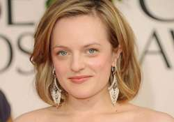 elisabeth moss compares acting with stripping