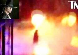 wwe undertaker catches fire in accident survives
