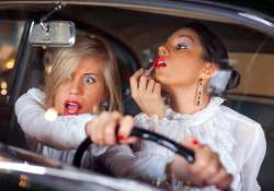 most women do up face while driving
