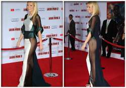 embarrassed paltrow gives a peek of her derriere in her