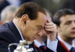 berlusconi in rare appearance at fraud case hearing