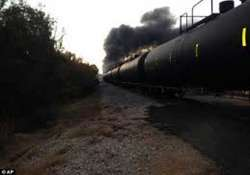dramatic video us train carrying crude derails bursts into