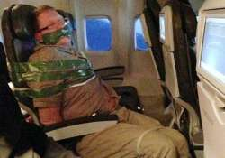 drunken man taped to plane seat by fellow passengers