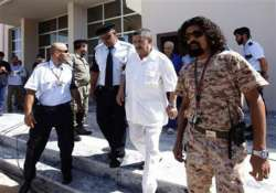 gaddafi era officials to stand trial thursday