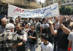 huge protests grip syria 6 killed in clashes