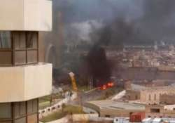 9 killed in suicide attack at a luxury hotel in tripoli