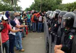 protesters take over airport in mexican city