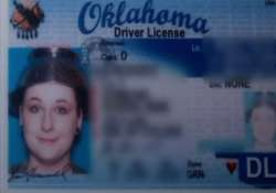 woman wears colander for driver s license photo