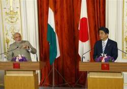 japan wooing india to contain china says chinese daily