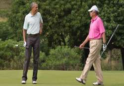 barack obama tees off in hawaii with malaysian prime