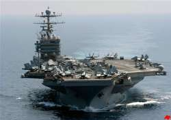 iranian boats shadow us aircraft carrier in gulf