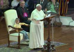 little boy sits in pope s chair steals the show