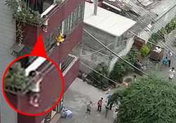 neighbours rescue boy dangling by the head from window