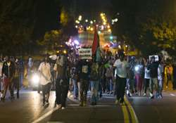 riots continue in us city after teenager s death